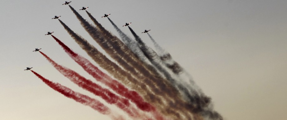 Egyptian military jets fly over Tahrir square as protesters who are against former Egyptian President Mohamed Mursi gather, in Cairo