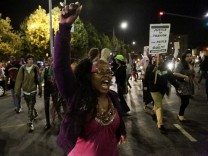 A protester marches in the Leimert Park area following the George Zimmerman verdict in Los Angeles