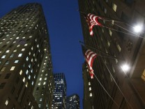 Flags fly outside 85 Broad St., the Goldman Sachs headquarters in New York's financial district
