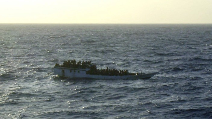 A picture released by the Australian Maritime and Safety Authority (AMSA) shows a boat which according to the AMSA was taken mid-morning before the boat sank near Christmas Island