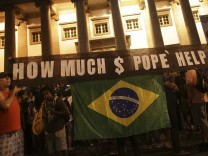 Protesters demonstrate against the visit by Pope Francis near Guanabara Palace in Rio de Janeiro