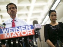 New York mayoral candidate Anthony Weiner and his wife Huma Abedin attend a news conference in New York