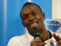 Jamaica's sprinter Usain Bolt speaks to journalists during a news conference one day before a Diamond League athletics meet in Londo