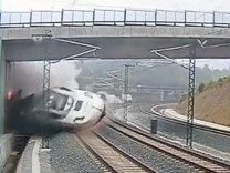 A train derails in this still image from the video of a security camera near Santiago de Compostela,