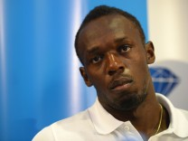 Jamaica's sprinter Usain Bolt speaks to journalists during a news conference one day before a Diamond League athletics meet in London