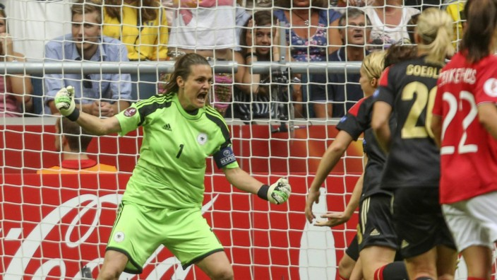 Germany's goalie Angerer reacts with teammates during their women's Euro 2013 final soccer match against Norway in Stockholm