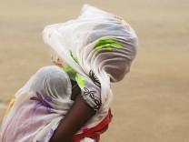 Flucht vor einem Sandsturm in Timbuktu, Mali