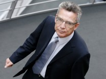 German Defence Minister De Maiziere takes break while appearing as witness at parliamentary inquiry committee in Berlin