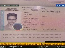 A picture of fugitive former U.S. spy agency contractor Edward Snowden in his new refugee documents granted by Russia in Moscow's Sheremetyevo airport