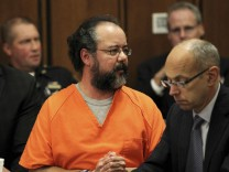 Ariel Castro, 53, speaks towards one of his victims Michelle Knight while seated between attorneys Craig Weintraub and Jaye Schlachet in the courtroom in Cleveland