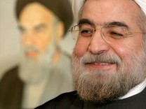 File photo shows Iran's chief nuclear negotiator Rohani speaking with Reuters correspondent in Tehran