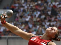 Second-placed Christina Schwanitz of Germany competes in the women's shot put event at the London Diamond League 'Anniversary Games' athletics meeting in east London