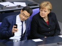 German Chancellor Merkel and Economy Minister Roesler attend Bundestag session in Berlin