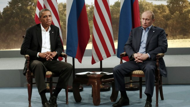 File picture of U.S. President Obama and Russian President Putin at the G8 Summit in Enniskillen
