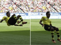 A combination photo shows Borussia Dortmund's Aubameyang celebrating his goal during the German first division Bundesliga soccer match against FC Augsburg in Augsburg