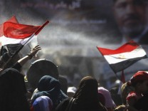 Members of the Muslim Brotherhood and supporters of deposed Egyptian President Mursi shout slogans while holding Egyptian flags, at Rabaa Adawiya square, where they are camping, in Cairo