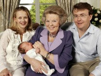File photo of Queen Beatrix of the Netherlands posing with her son Prince Johan Friso, his wife Princess Mabel and the couple's daughter Countess Luana