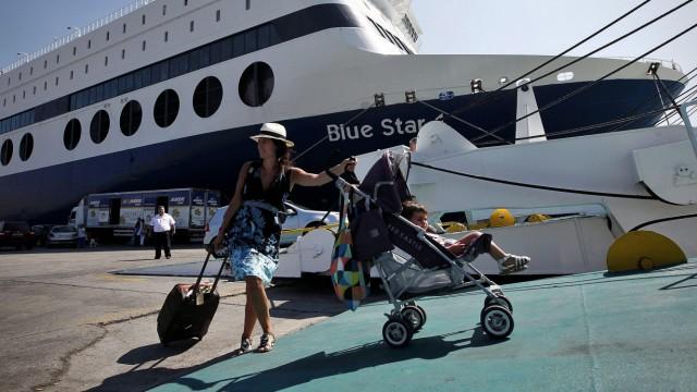 Tourists at the port of Piraeus