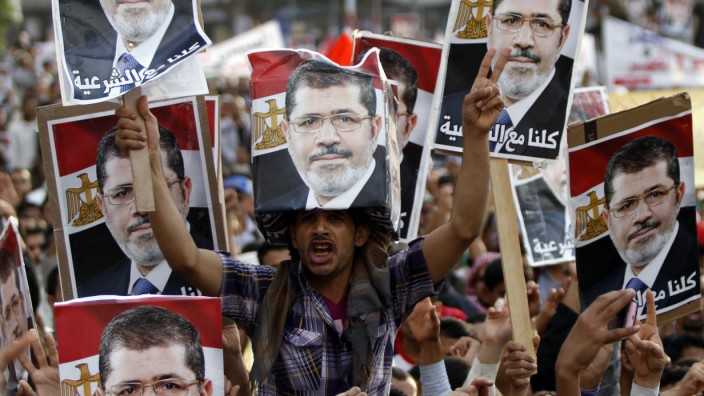 Supporters of deposed Egyptian President Mohamed Mursi shout slogans with the Egyptian flag during a march to show solidarity with his supporters in Egypt, in Sanaa