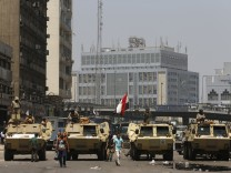 Soldiers stand guard on armoured personnel carrier positioned outside Ramses Square, near al-Fath mosque in Cairo