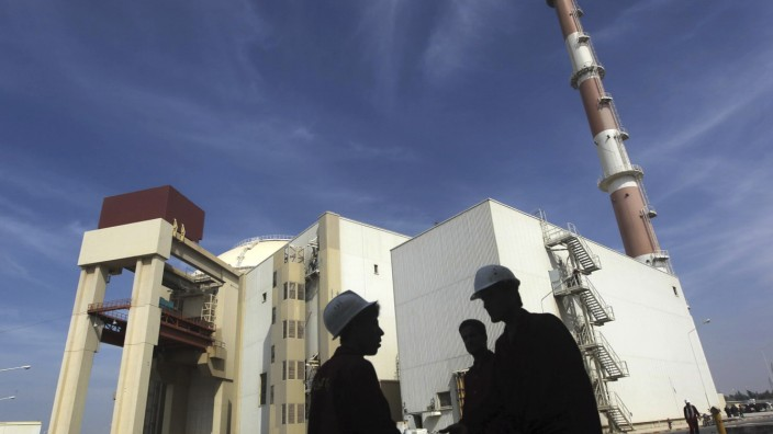 File photo of Iranian workers standing in front of the Bushehr nuclear power plant, about 1,200 km (746 miles) south of Tehran