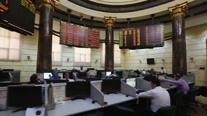 Traders work at the Egyptian stock exchange in Cairo