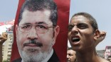 A member of the Muslim Brotherhood and supporter of ousted President Mohamed Mursi shouts slogans in Cairo