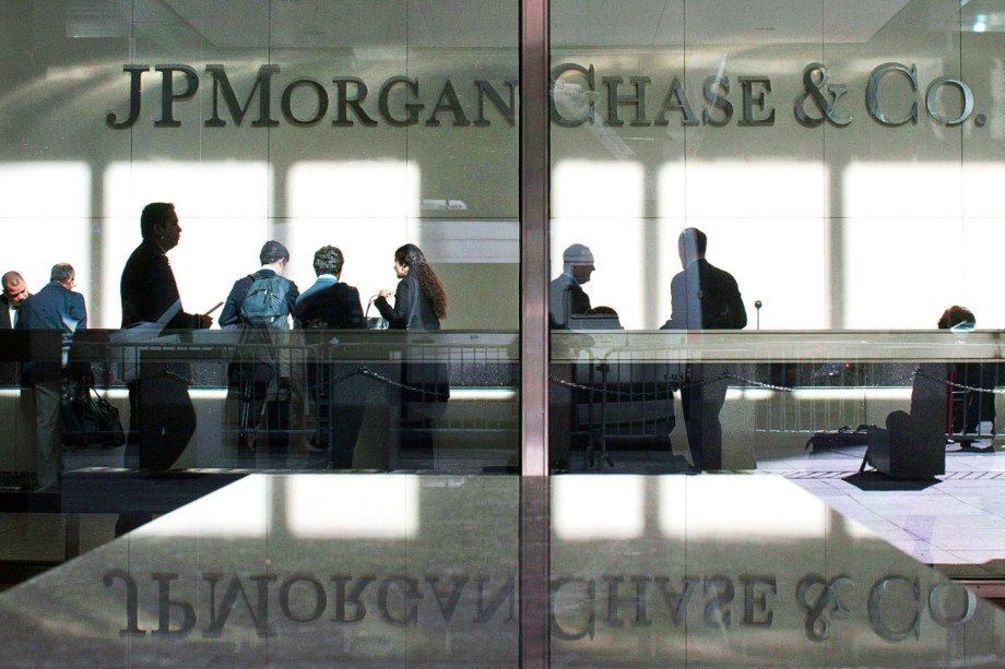 ce0feb4369fbc7 File photo of the lobby of JP Morgan headquarters is photographed through  it s front doors in