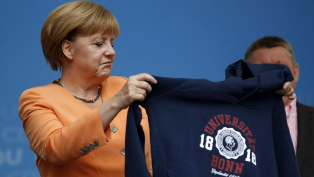 German Chancellor and CDU head Merkel holds university Bonn pullover after a CDU election campaign event in Bonn