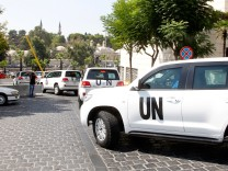 U.N. vehicles transport a team of U.N. chemical weapons experts to the scene of a poison gas attack outside the Syrian capital last week, in Damascus