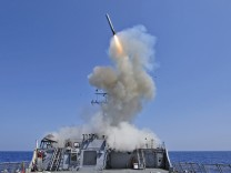 Handout photo of USS Barry launching a Tomahawk cruise missile in the Mediterranean Sea