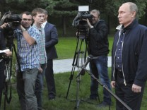 Russia's President Putin talks to journalists in Vladivostok
