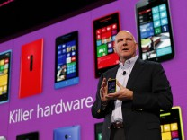 File photo of Microsoft Corp CEO Steve Ballmer displaying a Nokia Lumia 920 featuring Windows Phone 8, during an event in San Francisco