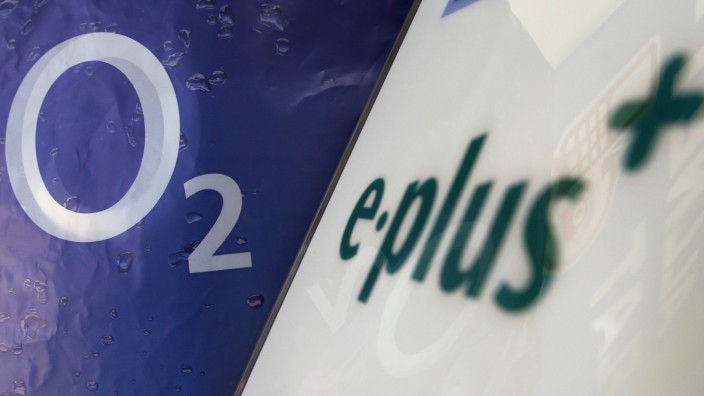 Logo of O2 Deutschland, German daughter of Spain's Telefonica is seen close to E-Plus logo in a store in Germering
