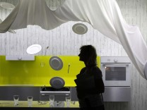 Visitor passes dishwasher installation during opening day of IFA consumer electronics fair in Berlin