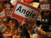 Supporters hold up placards that read 'Angie', the nickname of German Chancellor and conservative CDU leader Merkel, at the CDU's election campaign rally in Duesseldorf