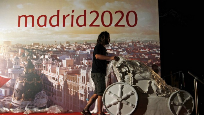A worker wheels away a replica of a famous Madrid fountain after Madrid was eliminated from the IOC voting for the 2020 Olympic games host city, in Madrid