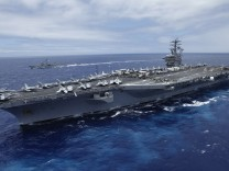 USS Nimitz aircraft carrier sails about 150 miles north of the island of Oahu during the RIMPAC Naval exercises off Hawaii in this file photo