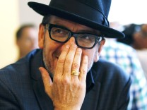 Singer Elvis Costello waits after Apple Inc's media event where Costello performed in Cupertino