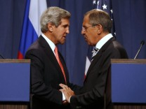 U.S. Secretary of State Kerry and Russian FM Lavrov shake hands after making statements following meetings regarding Syria, at a news conference in Geneva