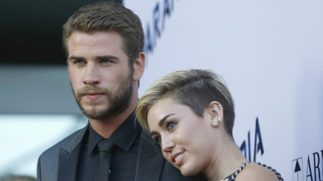 Hemsworth poses with Cyrus at premiere of 'Paranoia' in Los Angeles