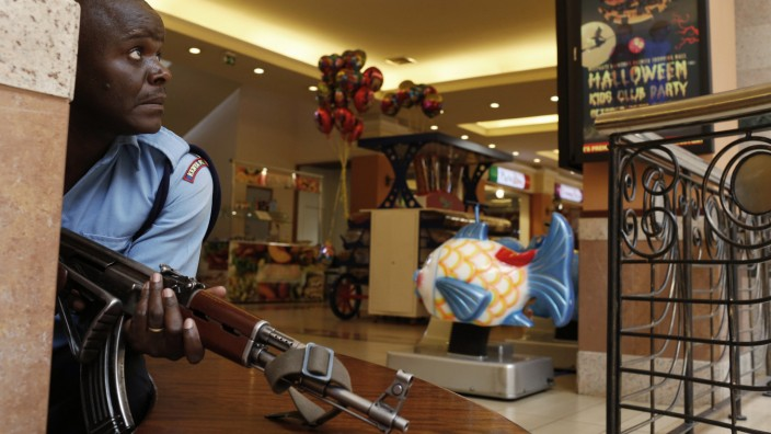 A police officer tries to secure an area inside the Westgate Shopping Centre where gunmen went on a shooting spree in Nairobi