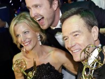 Gunn, Paul and Cranston celebrate the success of 'Breaking Bad' at the Governors Ball for the 65th Primetime Emmy Awards in Los Angeles