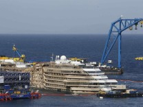 The capsized cruise liner Costa Concordia is seen at the end of the 'parbuckling' operation outside Giglio harbour