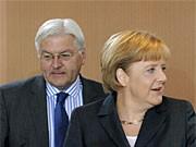 Steinmeier, Merkel, Reuters