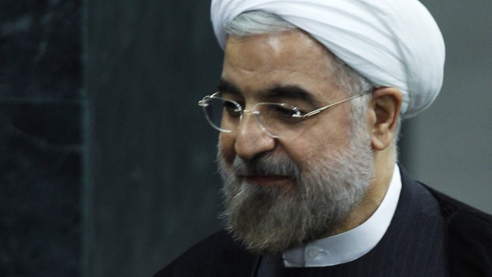 Iran's President Rohani exits after addressing a High-Level Meeting on Nuclear Disarmament during the 68th United Nations General Assembly in New York