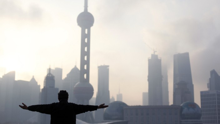 A man practices Tai Chi during an early morning session at the Bund in Shanghai