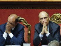 File photo of Italy's Prime Minister Letta next to Interior Minister Alfano during a vote session at the Senate in Rome