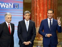 Faymann, Spindelegger and Strache pose before for a TV debate after first projections in the Austrian general election in Vienna