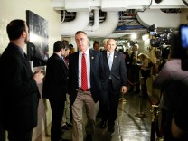 Members run a gauntlet of reporters as they arrive for a closed-door meeting of the House Republican caucus during a rare Saturday session at the U.S. Capitol in Washington